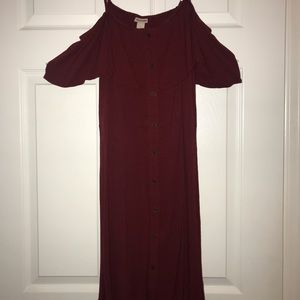 Dark red dress with cut out shoulders. Runs small.